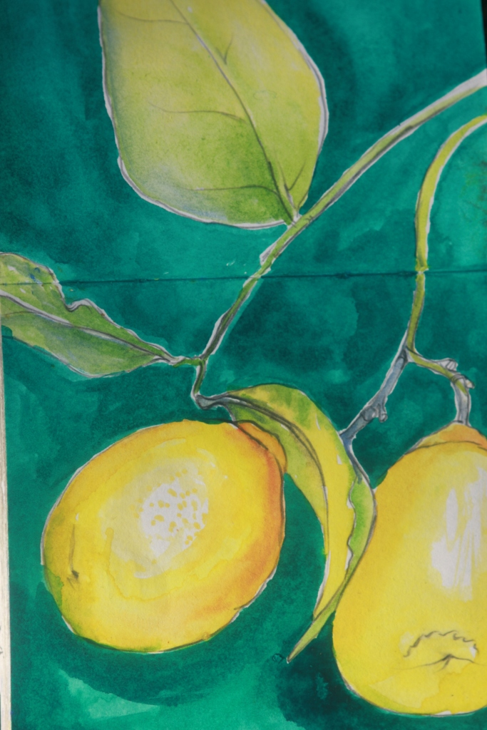 Lemons on a green table cloth.